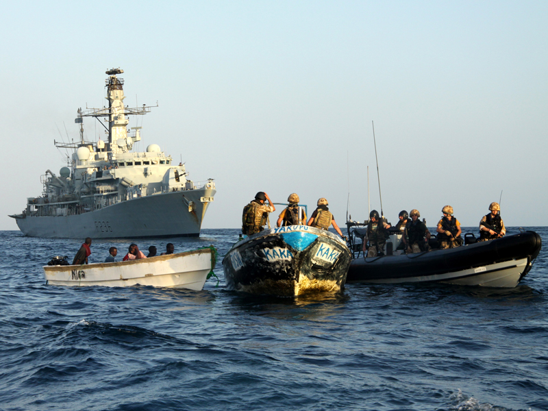 Royal Marines and sailors from HMS Montrose investigate a boat with suspected pirates onboard