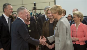 Defense Secretary Jim Mattis greets Italian Defense Minister Roberta Pinotti before a North Atlantic Council meeting at NATO headquarters in Brussels, Feb. 15, 2017. DoD photo
